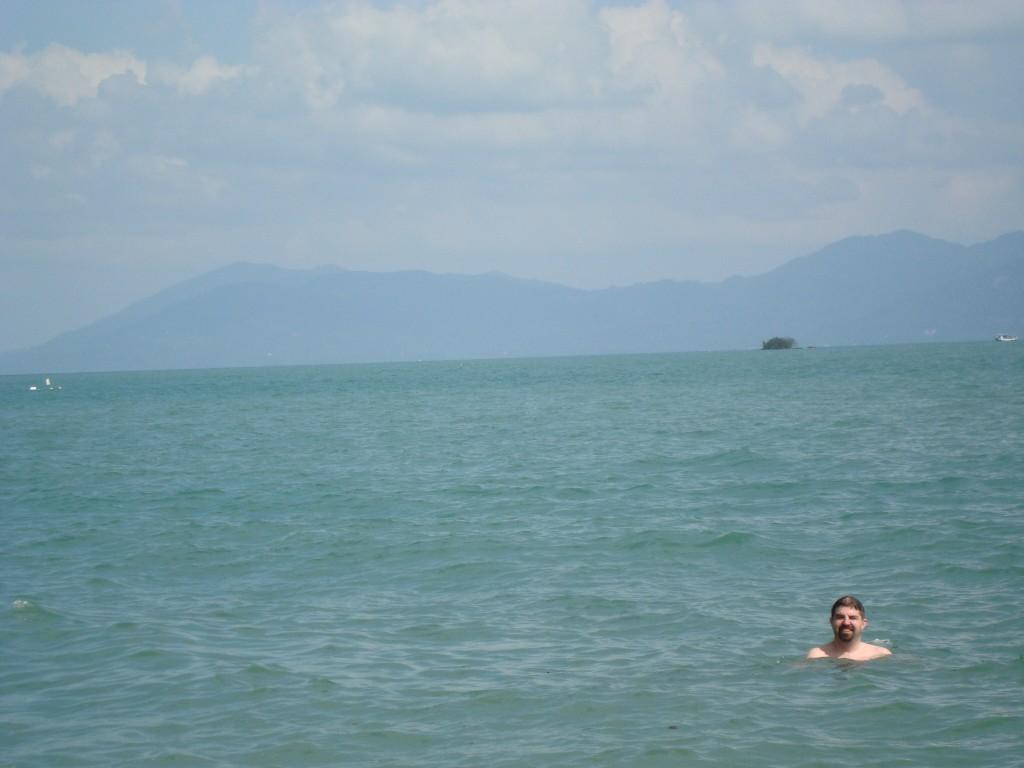 John in the water; Ko Pha Ngan in the distance.