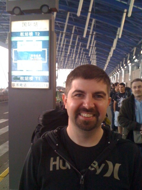 Waiting for a shuttle bus in the Shanghai airport after being dropped off at the wrong terminal for our flight