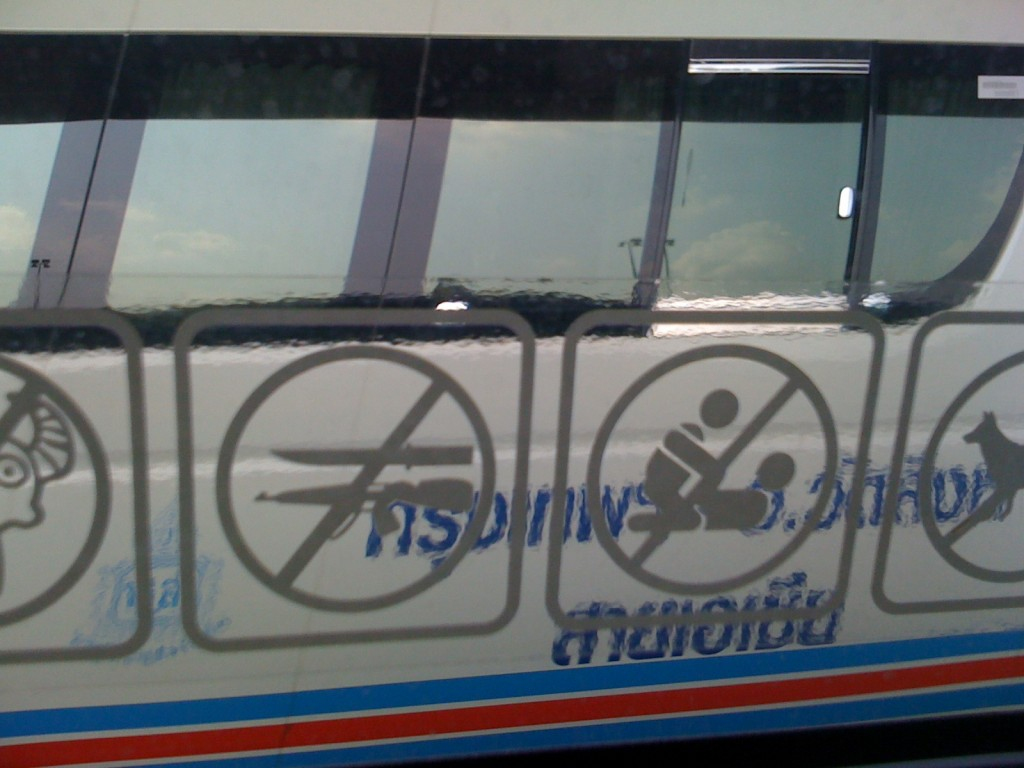 Warning sticker in Bangkok taxi. No knives, guns, or...Pilates?