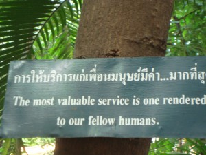 One of the many signs posted in the walkways in Wat Phra Singh