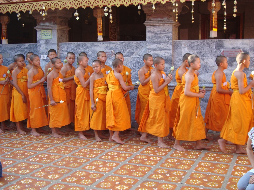 Young monks at Doi Suthep performing their evening ritual and prayer of walking around the Wat three times. Sunset was a beautiful time to visit.