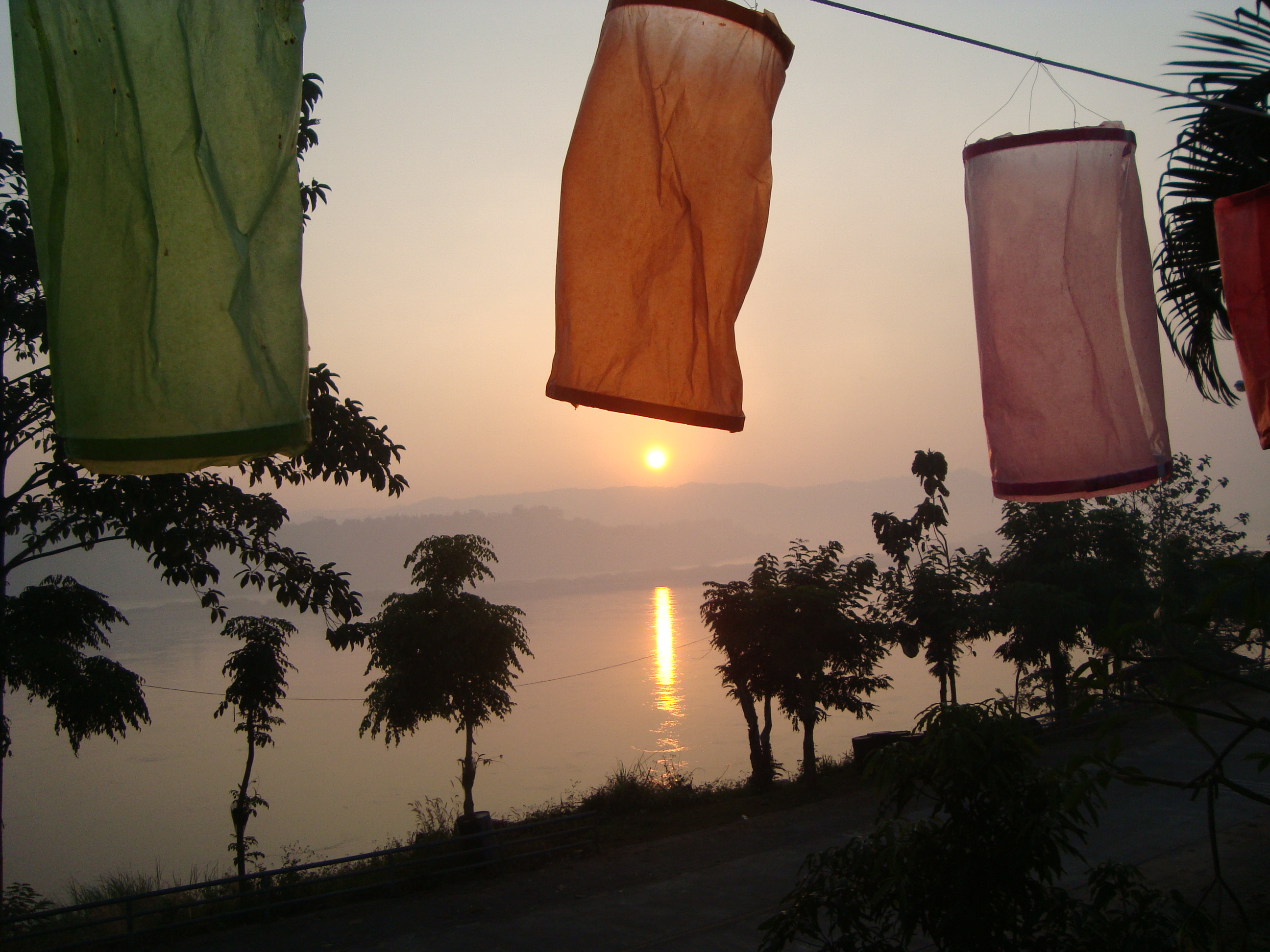 Sunrise on the Mekong River (from Thailand). Also our first glimpse of Laos across the river.