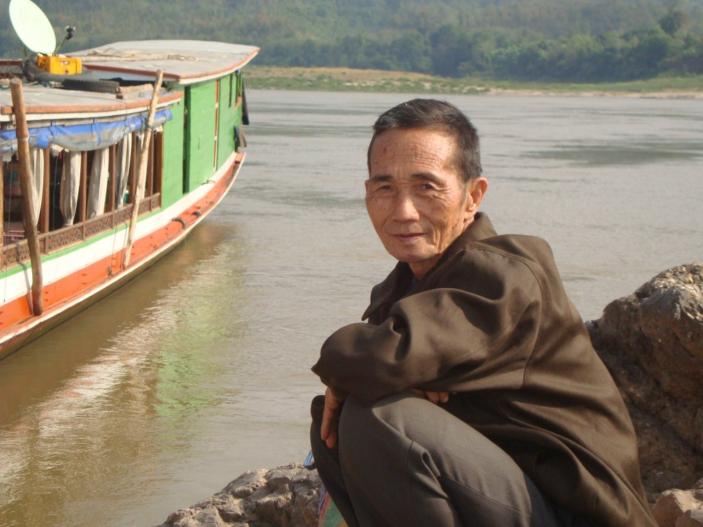 Lao man on the side of the Mekong River