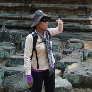 Our fantastic guide for Angkor Wat. Both days she wore two long sleeved shirts, pants, socks, and a backpack with waters for us. I couldn't understand how she did it!