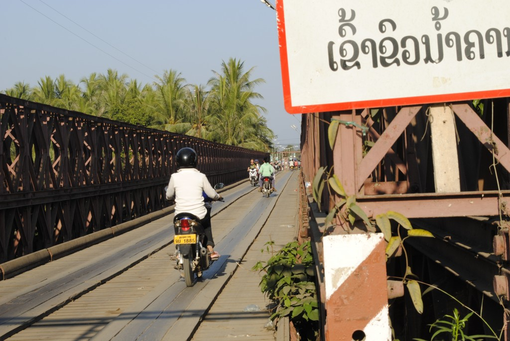 We were staying at a bungalow right on the other side of this bridge, which only allowed motorbikes and bicycles. We rode our bikes on it once and it is harder than it looks to stay on the planks! There was a pedestrian walkway on the side, see below.