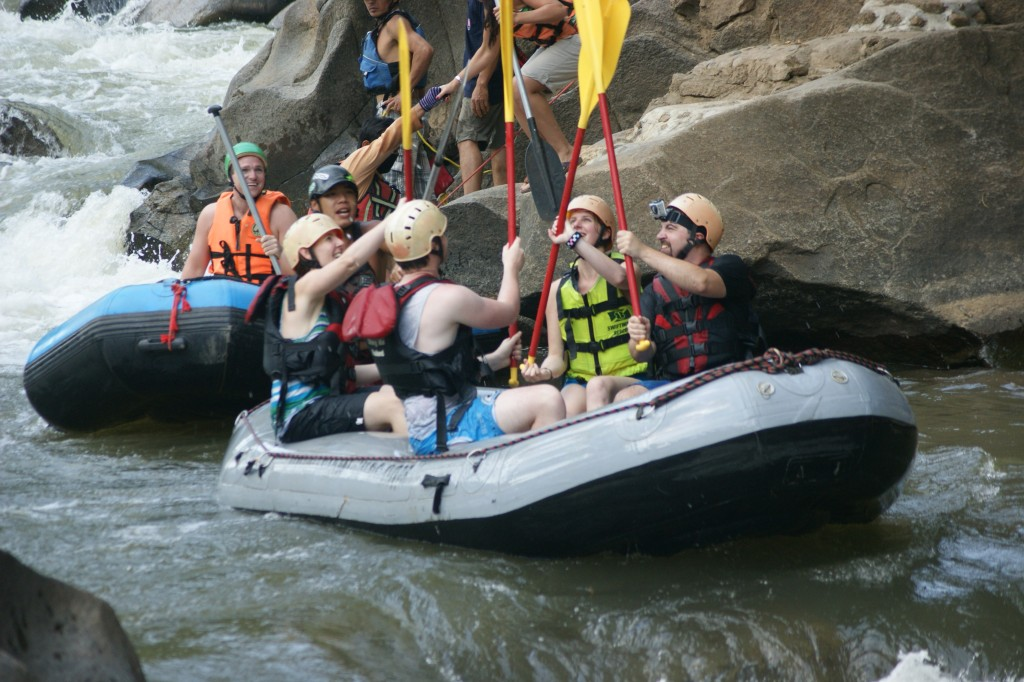 Our boat high-fiving after going through some rapids.