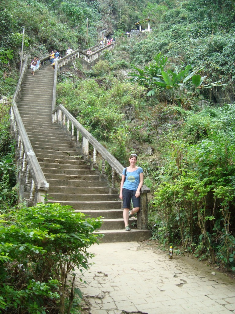 getting ready to climb lots of steps to see the Xang Cave, just on the edge of town