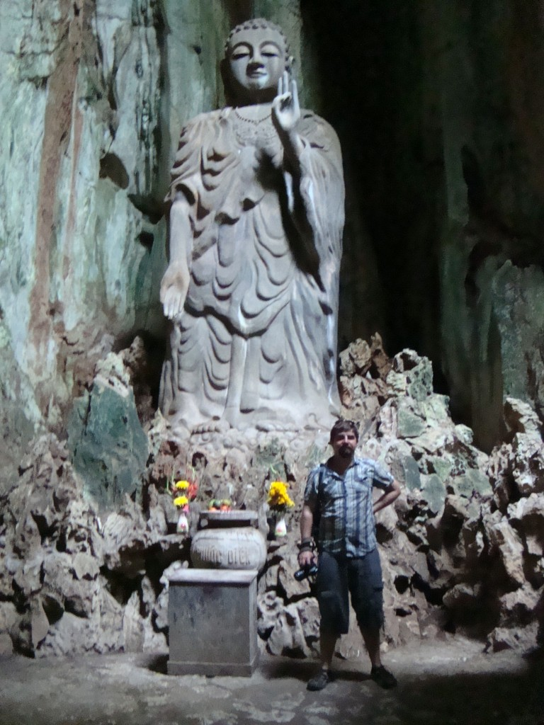 Even larger Buddha inside of a partial cave.