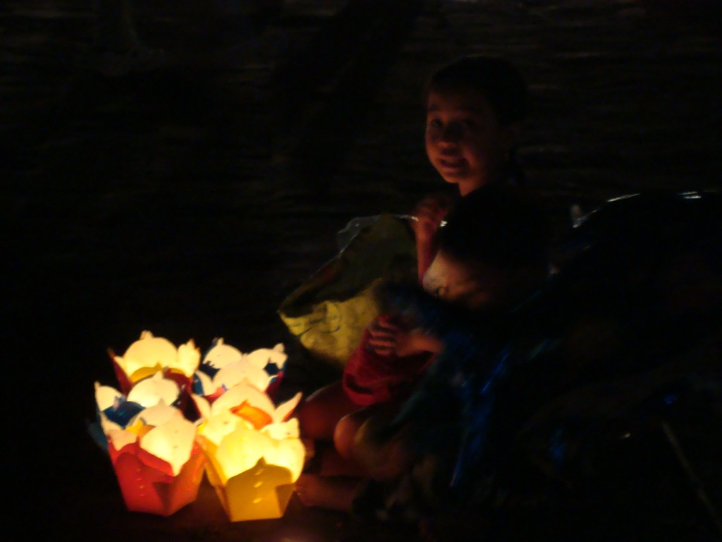 Every night women and kids would sell these floating lanterns for making New Years' wish.