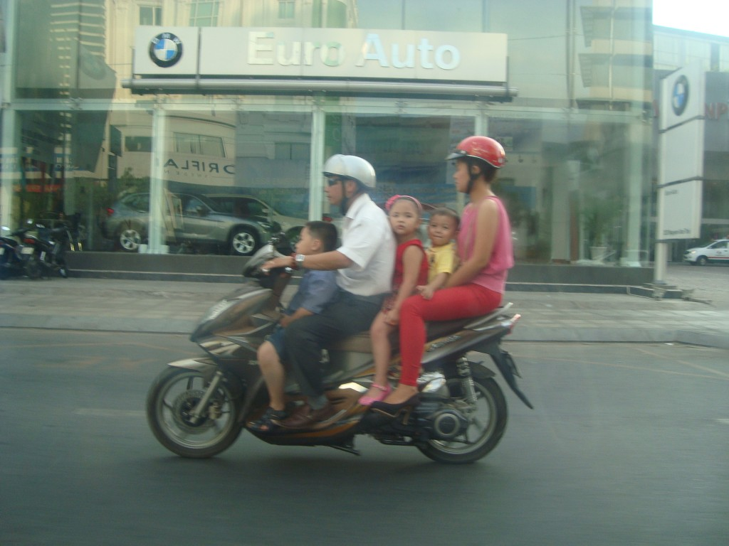 Common to see a whole family on a motorbike.
