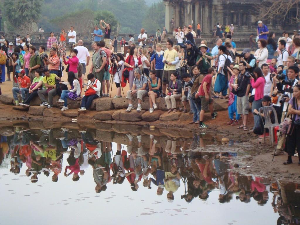 Crowds outside of Angkor Wat at sunrise.