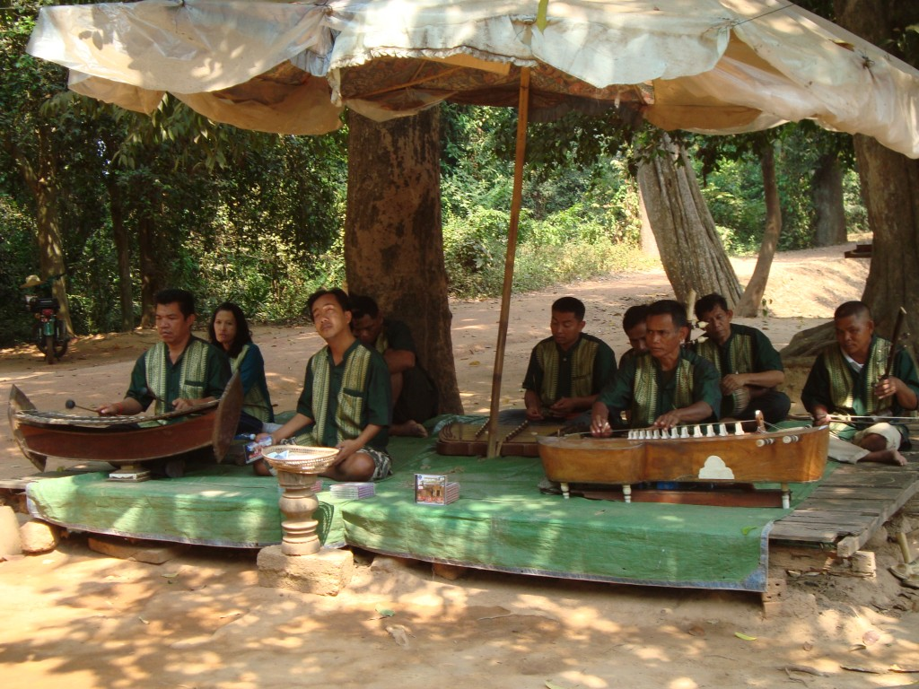 Cambodian musicians playing outside of Bantey Srei