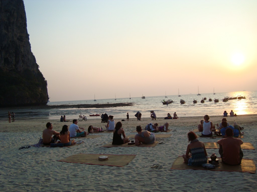 Folks just hanging out, watching the sunset. Railay Beach, Thailand