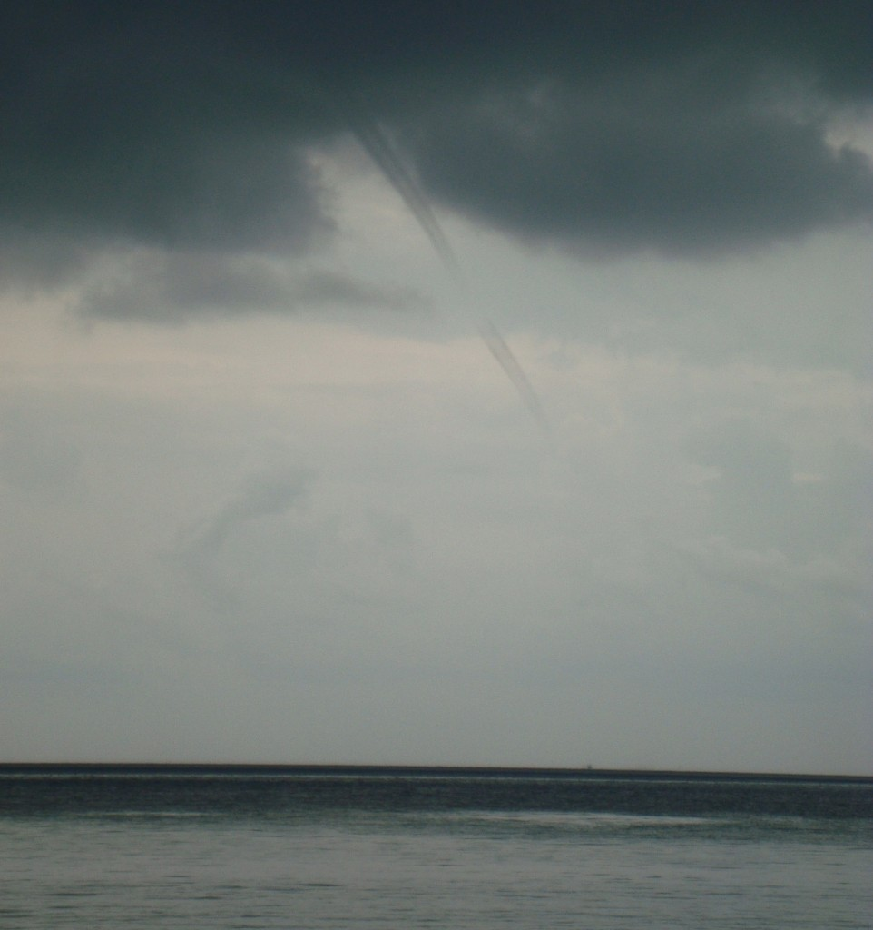 On our last day at the beach, this tornado-like water spout showed up. Luckily the clouds blew over by the afternoon.